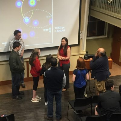 """An image of Dr. Battersby fielding questions from young """"proto-scientists"""" after a public talk."""