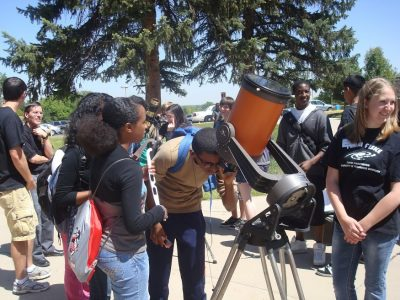 An image of students looking through a solar telescope