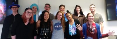 """An image of students from PHYS2701 dressed up in """"astro-themed"""" halloween costumes."""
